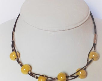 Bracelet, transformable choker with ceramic pearls