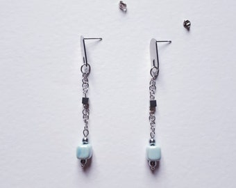 Long pendant earrings with blue cube ceramic