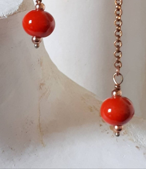 Long pendant earrings with Greek ceramic pearl