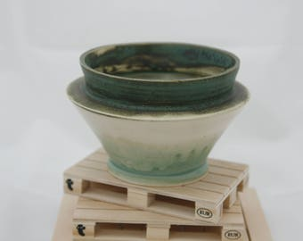 Stoneware blue glazed bowl.