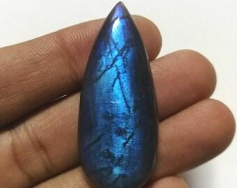 AAA Blue Labradorite cabochon teardrop shape. 47x20mm size. Deep blue color.