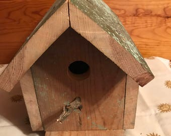 rustic bird house with rear porch perch