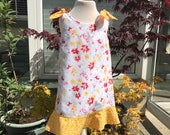 2-3 yrs old, summer girls cotton dress with yellow and red flowers print, lined, two removable bows on slieves, with matching hair bow clip.