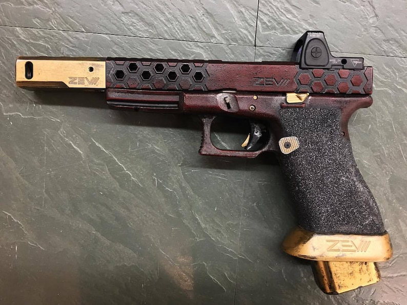 A prop styled after Deadshot's Glock 17 ZEV