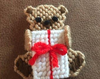 Cute little bear holding a gift