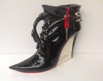 Gothic ladies stiletto ankle boot teapot.