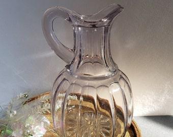 A beautiful vintage antique French brass olive oil vinegar jug.
