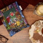Padded book sleeve made with Beauty and The Beast fabric ~  book cover ~ book bag ~ book protector ~ book cosy  ~ book pouch