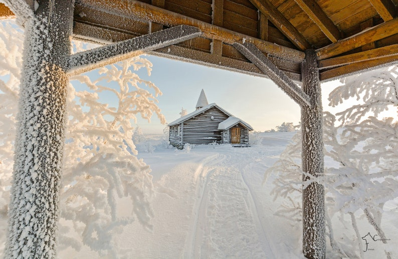 Wall hanging of a log chapel frozen in place image 0