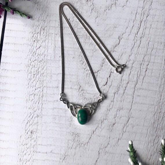 Celtic knot malachite necklace.