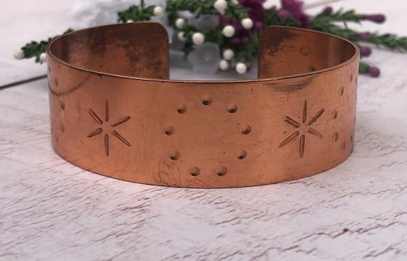 Copper Cuff Bracelet With Star Patterns.
