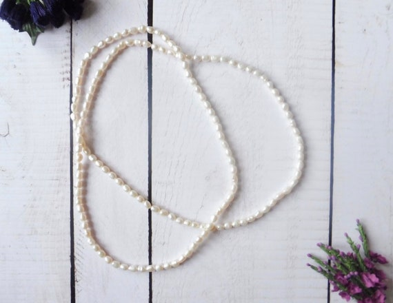 Long strand of ivory baroque cultured pearls.