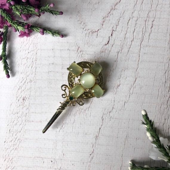 Scottish shirld and daggar brooch.