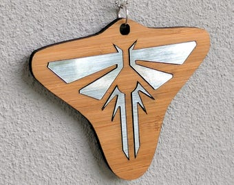 TLOU Fireflies pendant, bamboo and metallic silver, laser cut.  The Last of Us inspired.