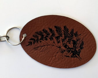 TLOU Ellie's Tattoo Key chain, laser engraved on brown or grey leatherette. The Last of Us
