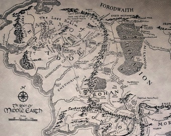 Map of Middle Earth laser engraved in stunning detail on leather-like leatherette. Ready to hang or frame. Great gift for Tolkien lovers!