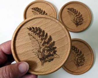TLOU set of four solid wood coasters, Ellie's Tattoo laser engraved on each coaster. The Last of Us inspired