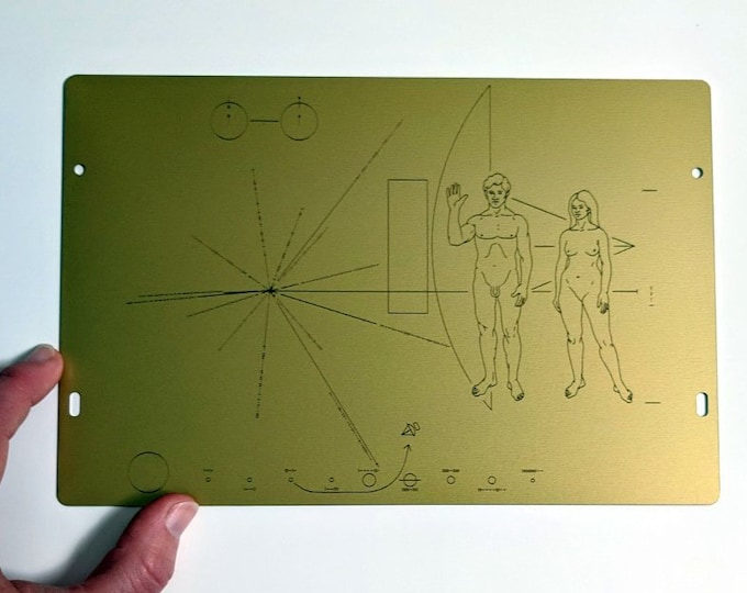Full size metal replica of NASA Pioneer Plaque, laser engraved and laser cut from golden aluminum. Two colour options to choose from!