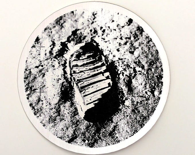 Buzz Aldrin bootprint on the moon sticker. Photo from the first moon walk, 1969, laser etched. NASA Apollo 11
