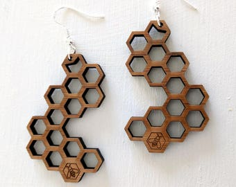 Honeycomb earrings, laser cut from sustainable bamboo, with a little bee laser engraved.