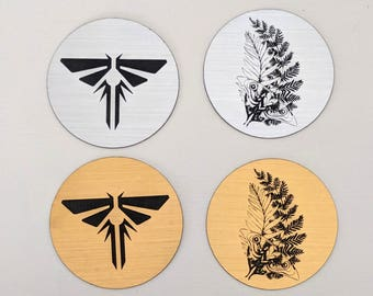 The Last of Us magnet, metallic silver or gold. Fireflies symbol and Ellie's tattoo from TLOU2, laser engraved. TLOU TLOUp2