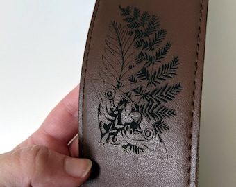 Custom engraved leather guitar strap, laser engraved with your choice of text and/or images. Brown leather Fender strap. TLOU