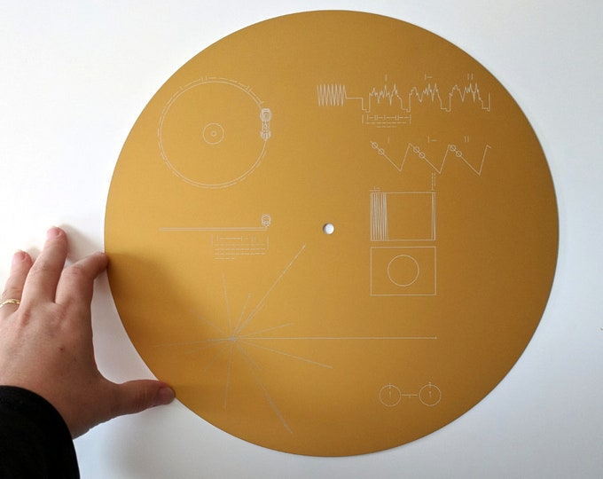 "Double sided metal Voyager Golden Record full size replica - laser engraved, featuring the iconic cover and ""Sounds of Earth"""