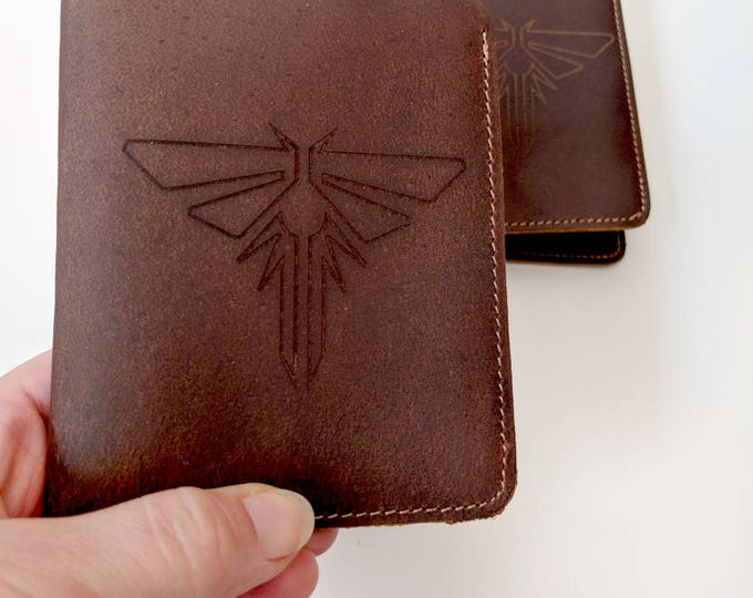 Genuine leather rawhide wallet, laser engraved with The Last of Us Fireflies symbol. Can be custom engraved!