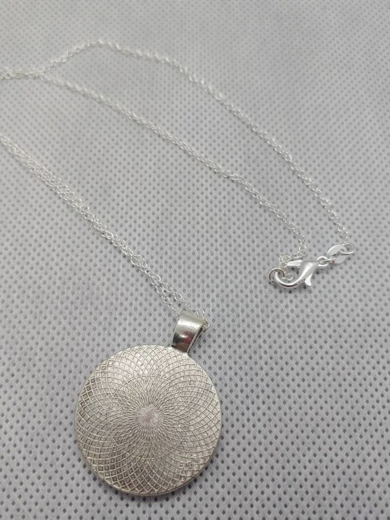 Sun and Moon Stamped Witch Pendant with Silvertone Chain