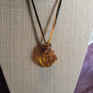 Tangerine Solar Ray Andara with 22 inch dark chocolate and deerskin necklace.