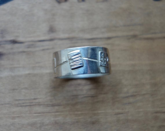 Sterling Ring in silver with texturing, hammering, etching. Unisex ring.