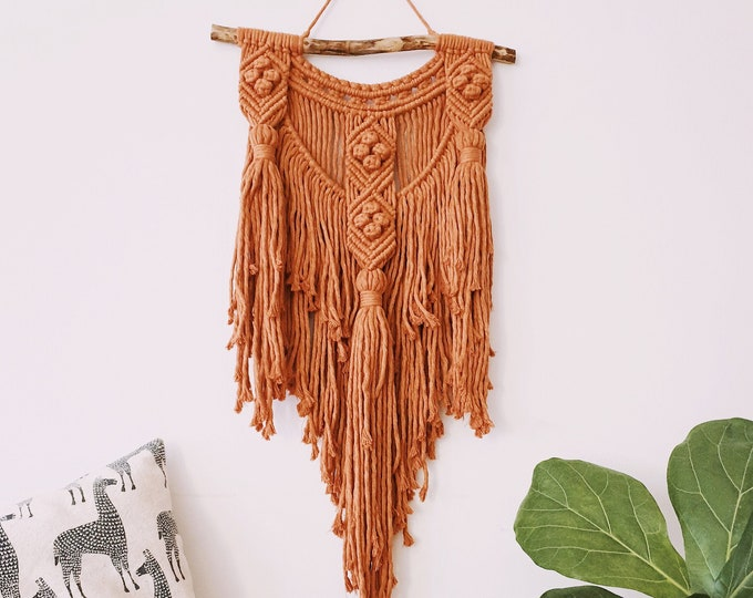 Tenna - medium macrame wallhanging / tapestry made from terra-cotta / rust colored cotton with a chunky tassels and berry knots