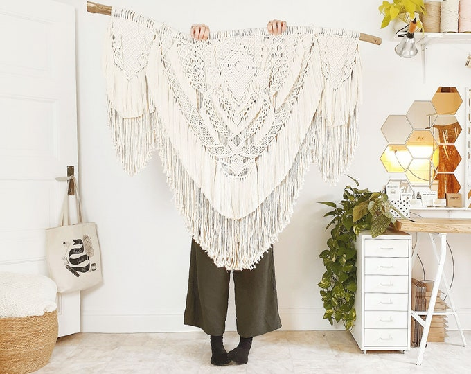 Mollie - extra large macrame wallhanging / tapestry made from all natural materials in natural white tones on driftwood