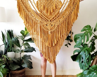 Ina - extra large macramé wall hanging / macramé tapestry made from all natural materials in mustard tones on driftwood with raw crystal