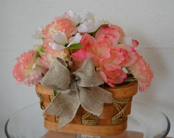 Beautiful flower arrangement with peach carnations and coral/peach peonies. One of a kind. (Not real flowers.)