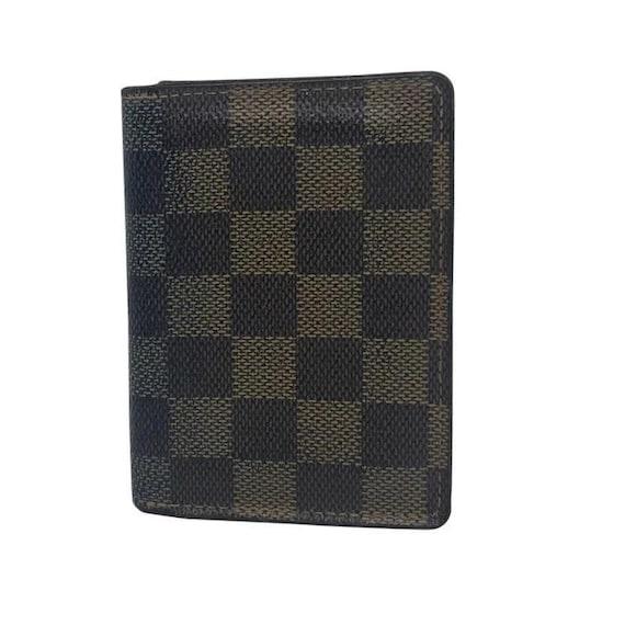 46e471b30ba2 A Louis Vuitton Damier Ebene Card Holder
