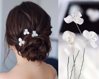 Wedding hairpins with flowers from translucent white clay with silver sequins, Jewelry in the hairstyle for the bride or bridesmaids