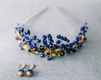 Wedding crown of blue color, with gold leaves and accessories
