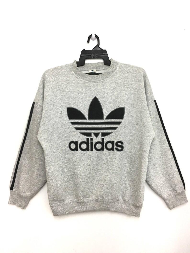 62b7e27401457 Made In Canada Vintage 80s 90s ADIDAS Trefoil Sweatshirt Big Logo By Priva  Sport Medium Size on tag