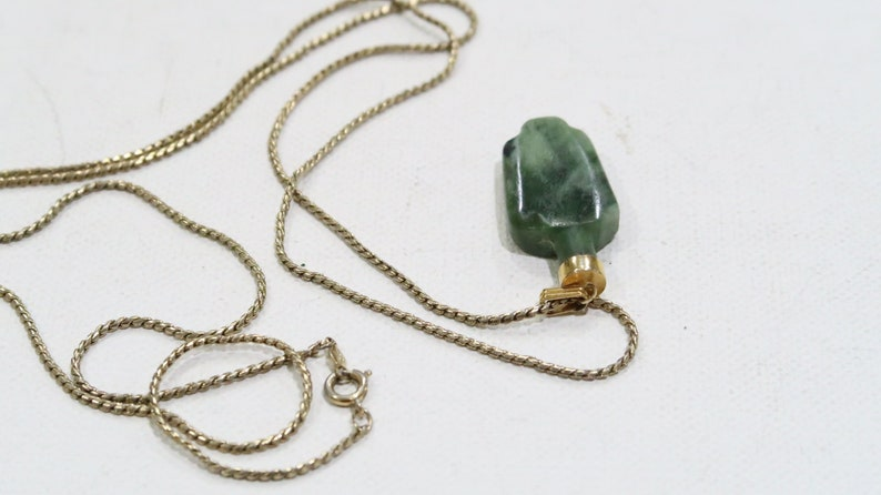 Carved jade flask pendant on a long Sarah Coventry chain