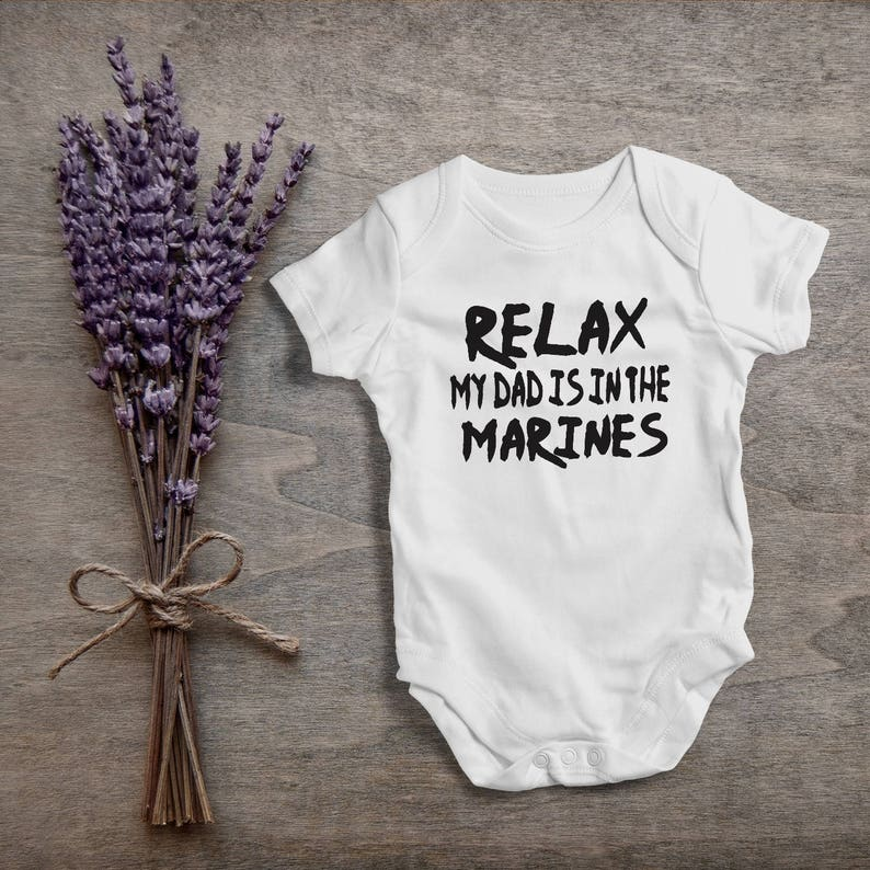 4e13eb5a8 Relax my dad is in the marinesfunny baby bodysuitone | Etsy