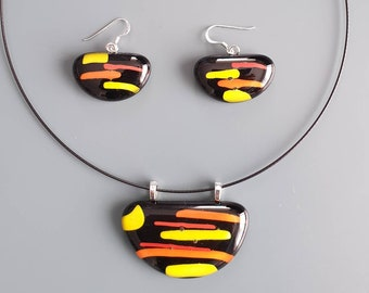 Black, yellow and orange glass pendant and earrings