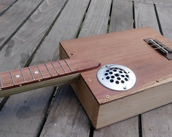 The Keyhole 3-String Electric Cigar box Guitar