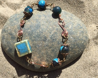 Copper wire and blue bead bracelet