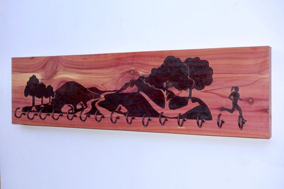 Trail Runner Girl, race medal holder, woodburned on cedar
