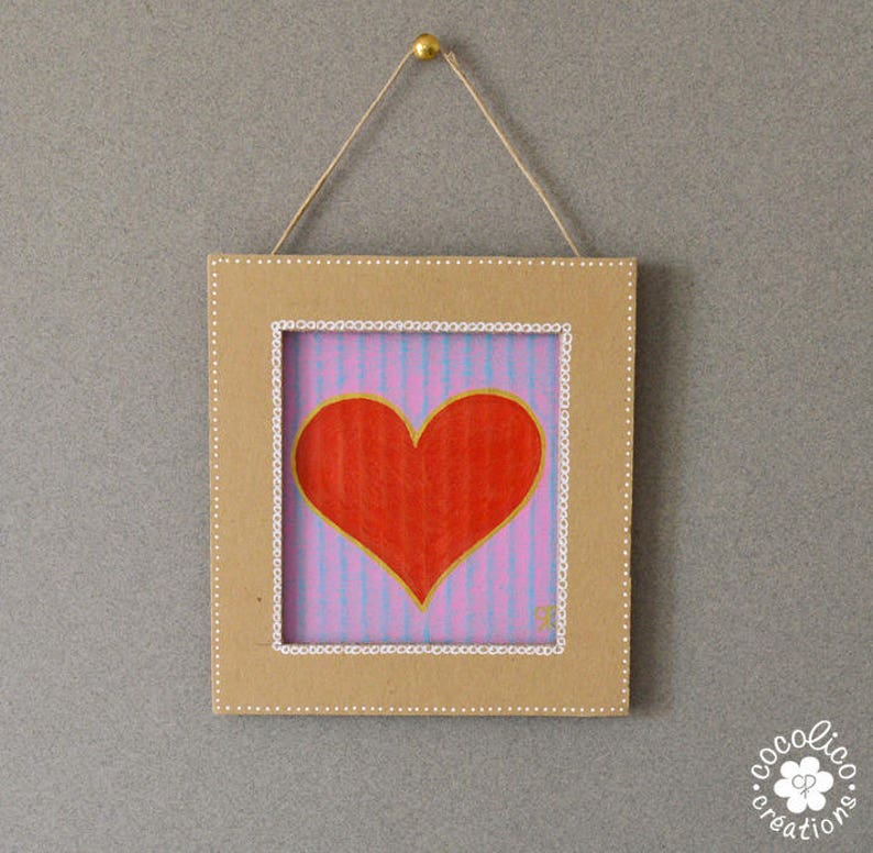 Cardboard frame painted red heart on purple background image 0
