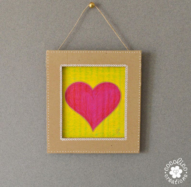 Cardboard frame painted pink heart on yellow background image 0