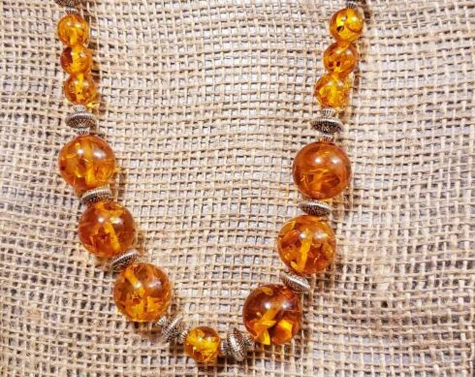 Amber necklace with silver accents and a strong magnetic clasp