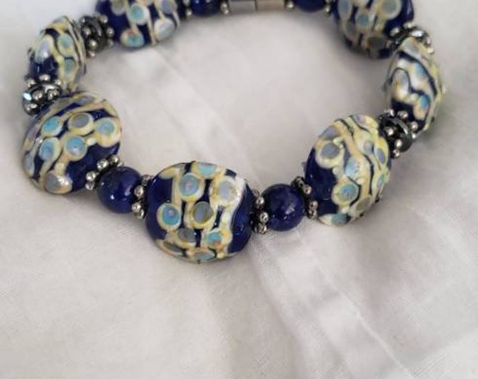 Italian glass beads with Lapis Lazuli gemstones and pewter accents.