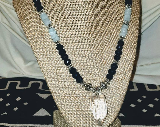 Quartz crystal pendant on a Sapphire and Aquamarine necklace